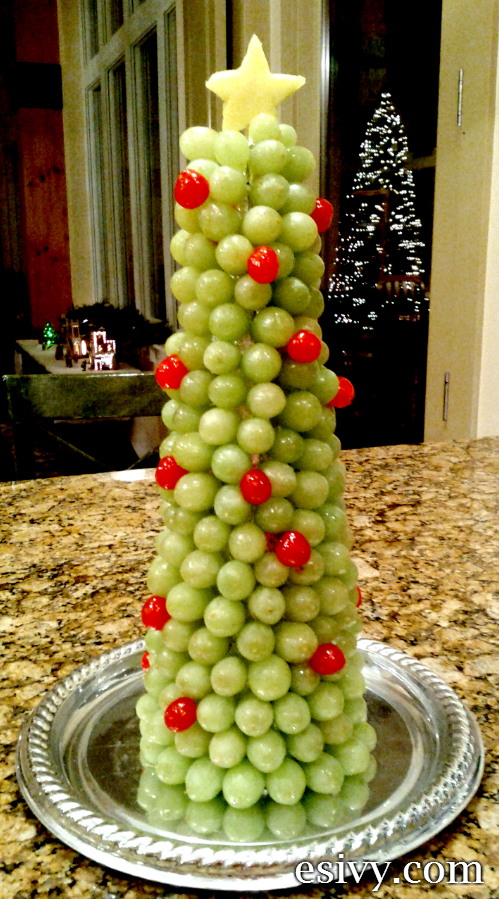 Here's a fun idea for a way to take a fruit platter to the classroom Christmas party -  A standing grape and cherry Christmas tree! It's also a great centerpiece for any Christmas party.