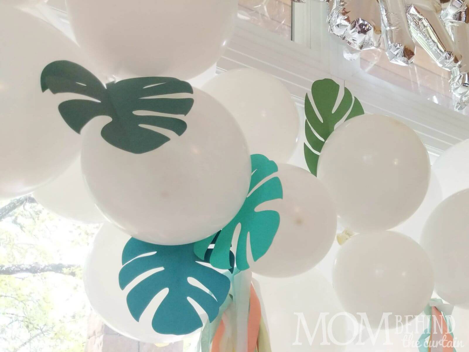 Cricut or laser cut paper decorated balloon garland birthday party decoration idea.