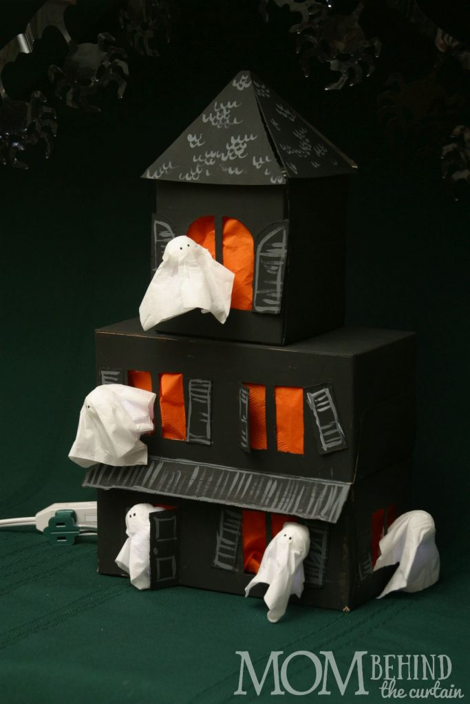 Here's a Halloween craft your kids can help with that makes a great centerpiece decoration for your Halloween party. A Haunted House out of recycled boxes!