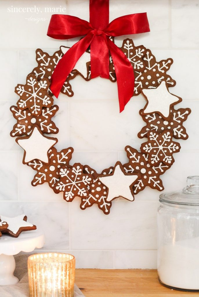 12+ of my favorite Christmas wreath tutorials, including this Gingerbread Snowflake Wreath! Learn how to make wreaths to decorate your home, everywhere from your front door to your kitchen! The wreaths use everything from fresh evergreens to these puzzle pieces (a genius way to save money when you make your wreath. You gotta see it!) and everything in between. Check it out to get some fabulous ideas.