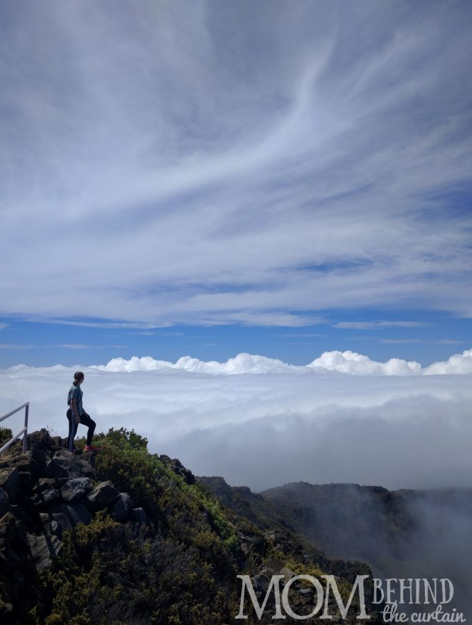 Maui is famous for the Huleakala Summit Sunrise! But you need a 3 am wakeup call and ski clothing. Miss the crowds! Read day trip tips - totally worth it! Girl above the clouds Leleiwi Lookout Maui