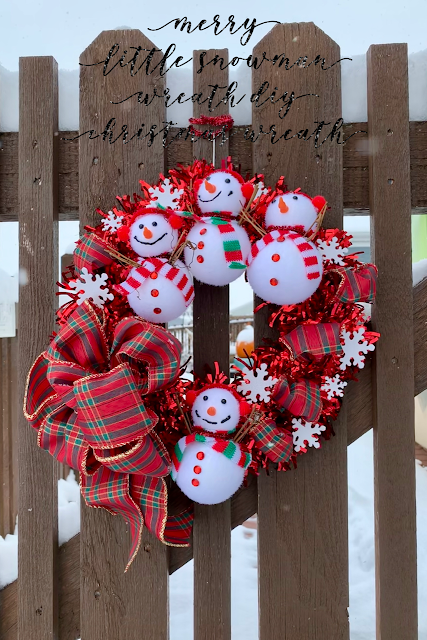 12+ of my favorite Christmas wreath tutorials, including this Tinsel Wreath with adorable snowmen. Learn how to make wreaths to decorate your home, everywhere from your front door to your kitchen! The wreaths use everything from fresh evergreens to puzzle pieces (a genius way to save money when you make your wreath. You gotta see it!) and everything in between. Check it out to get some fabulous ideas.