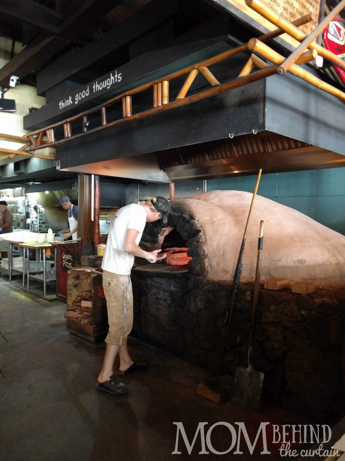 Man putting pizza in wood fired over, Best placae for lunch on Maui The Flatbread Company, Pa'ia