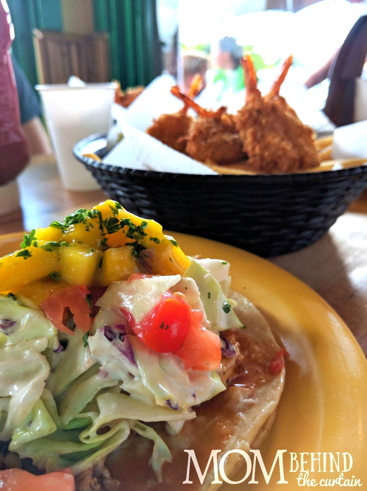 Best places to eat in Maui - don't miss out on delicious meals like these coconut shrimp and Hawaiian fish tacos with tropical mango and slaw.
