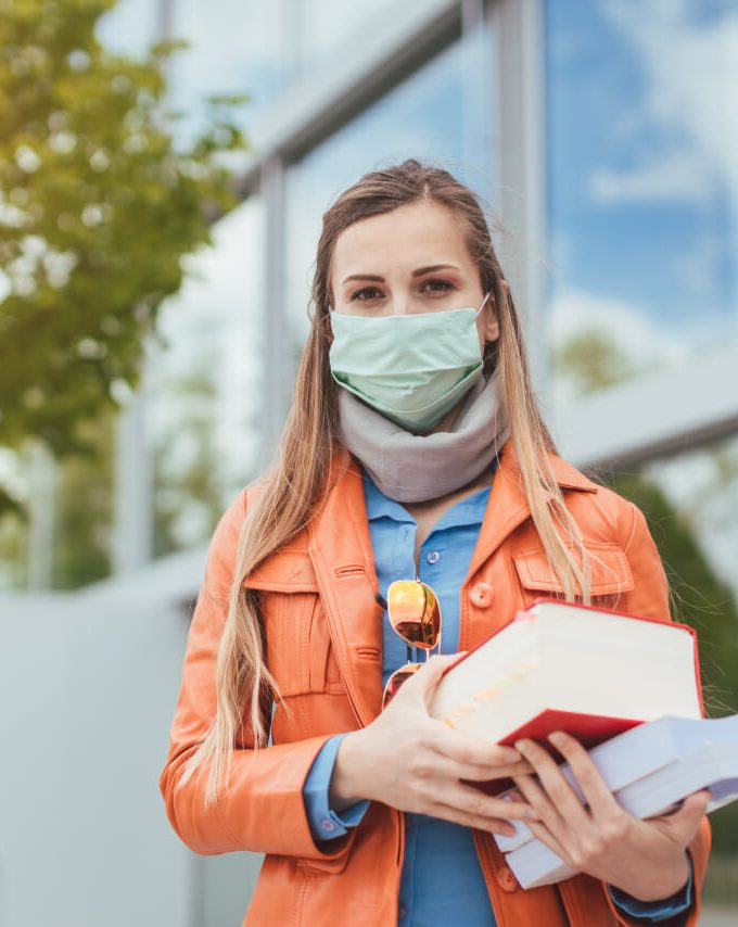 A girl prepared to go to college during Covid coronavirus.