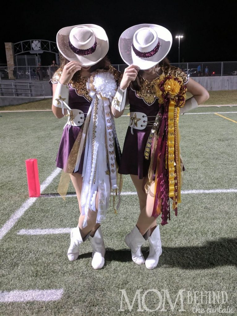Texas drill team members on football field wearing DIY homecoming mums from this tutorial.