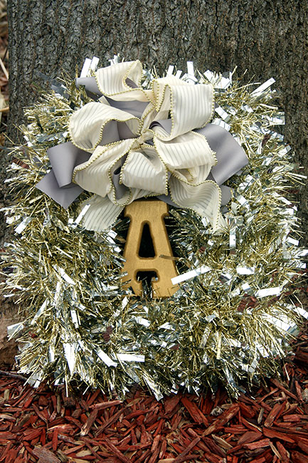 This unique Square Tinsel Wreath is on of my 12+ favorite Christmas Wreath tutorials. Learn how to make wreaths to decorate your home, everywhere from your front door to your kitchen! The wreaths use everything from fresh evergreens to puzzle pieces (a genius way to save money when you make your wreath. You gotta see it!) and everything in between. Check it out to get some fabulous ideas.